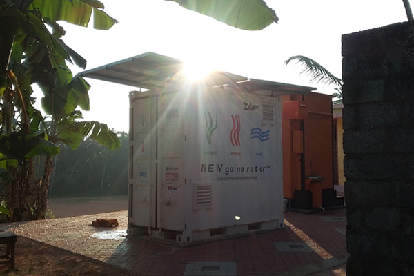 A view of the human waste converter with the sun behind.