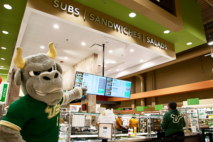 Rocky standing in the deli at the new USF Publix.