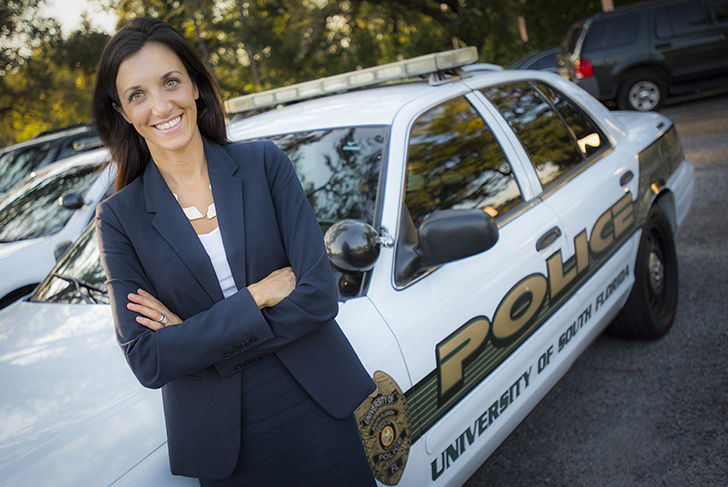 Dr. Bryanna Fox in front of USF police car