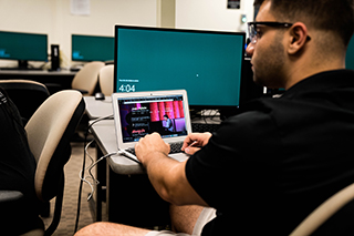 USF student working on the new website for Battistini.