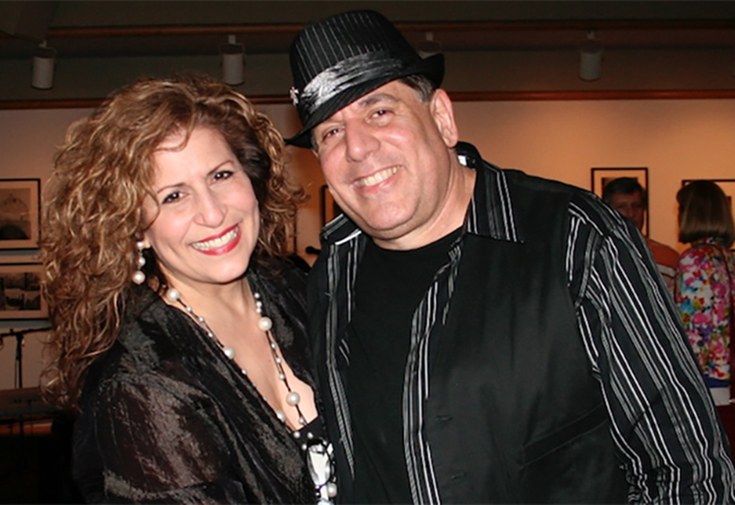 Grammy winning musician Lannie Battistini (right) with his wife and marketing director Neysa Rodriguez-Battistini.