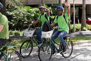 students riding the Share-a-Bull Bikes