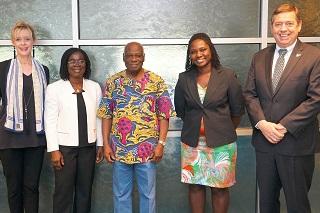 Ghana scholars visit USF. Members of USF Senior leadership posing with two female scholars from Ghana.