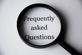 "Frequently Asked Questions. The picture shows a magnifying glass framing the words ""frequently asked questions."""